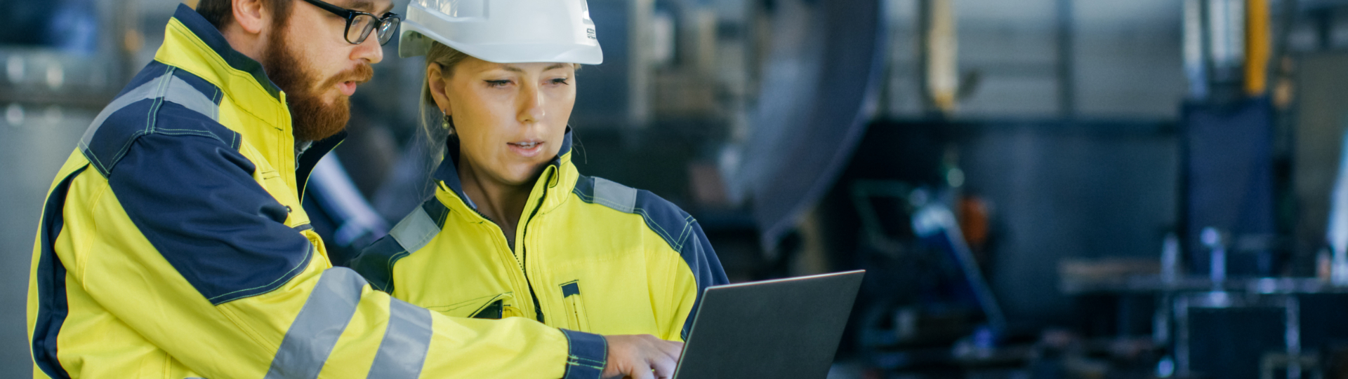 Man and Women Engineer Review Mobil Serv Laptop in Wear house